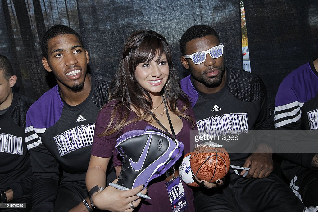 Jason Thompson and Tyreke Evans of the Sacramento Kings pose for a photo with a fan before Open Practice on October 28, 2012 at Sleep Train Arena in Sacramento, California.
