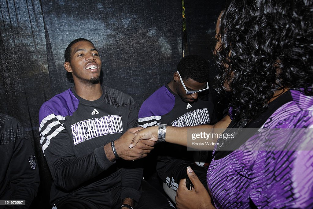 Jason Thompson of the Sacramento Kings greets a fan before Open Practice on October 28, 2012 at Sleep Train Arena in Sacramento, California.
