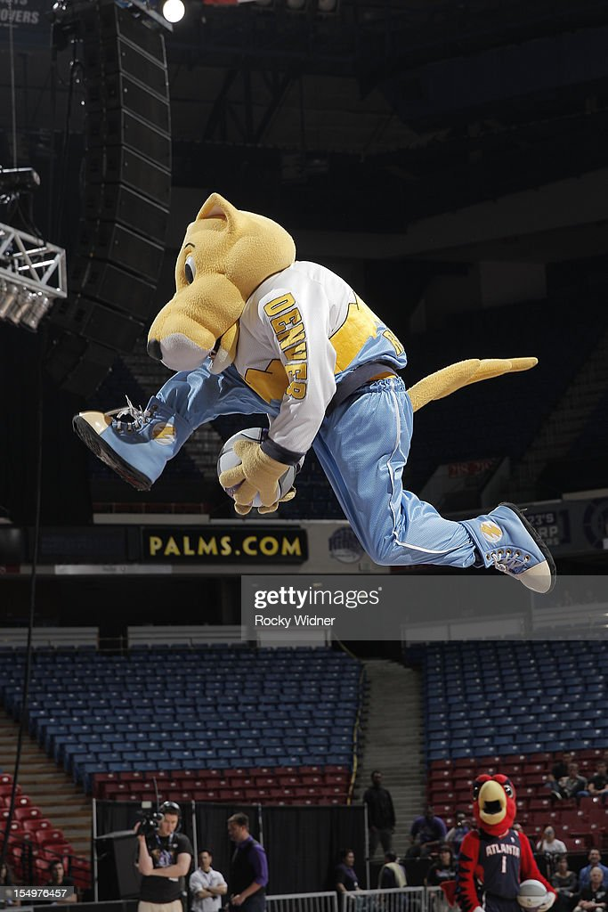 Rocky mascot of the Denver Nuggets goes for a dunk during Open Practice of the Sacramento Kings on October 28, 2012 at Sleep Train Arena in Sacramento, California.
