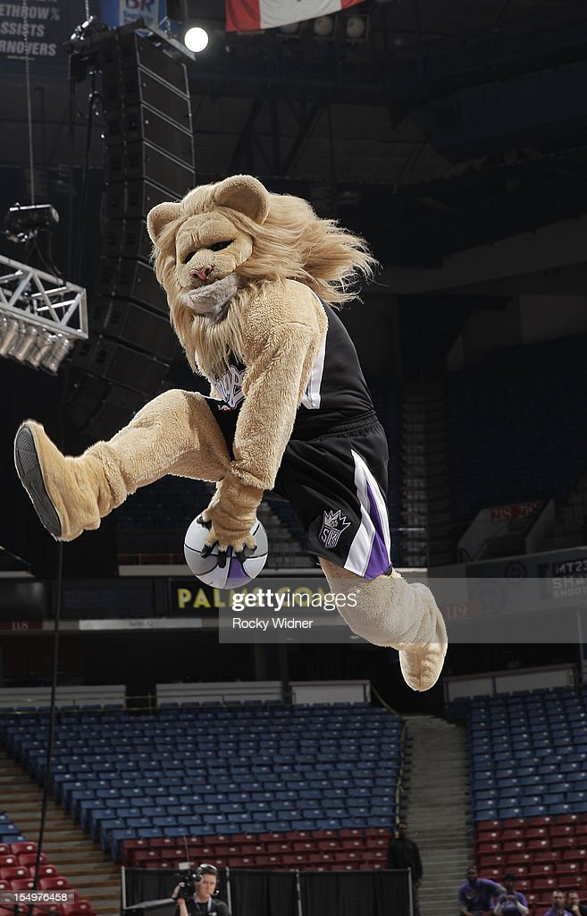 Slamson mascot of the Sacramento Kings goes for a dunk during Open Practice on October 28, 2012 at Sleep Train Arena in Sacramento, California.