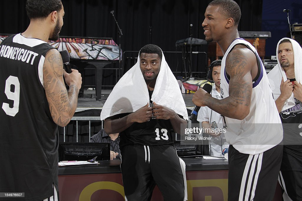 Tyler Honeycutt and Thomas Robinson of the Sacramento Kings sing happy birthday to Tyreke Evans during Open Practice on October 28, 2012 at Sleep Train Arena in Sacramento, California.