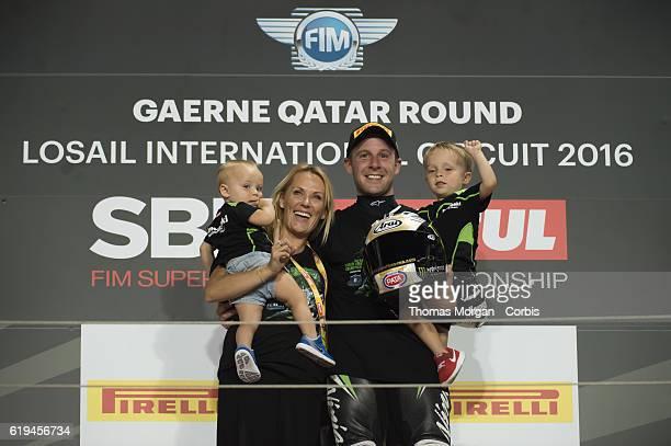 DOHA QATAR October 29th 2016 Losail Circuit Qatar Jonathan Rea who rides Kawasaki for Kawasaki Racing Team celebrates on the podium with his family...