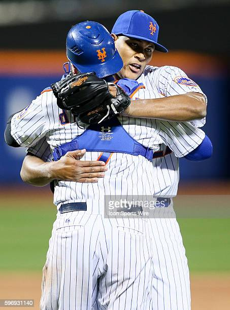 New York Mets relief pitcher Jeurys Familia [7925] and battery mate New York Mets catcher Travis d'Arnaud [7075] embrace as Familia retires Kansas...