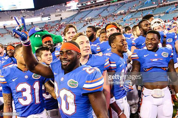 Florida Gators safety Marcus Maye leads other players during a celebration following the win after a NCAA football game between the Florida Gators...