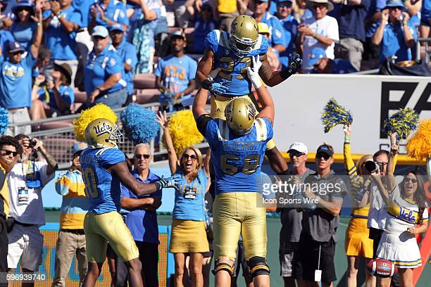 UCLA running back Nate Starks celebrates with UCLA Conor McDermott after Starks scores a touchdown during the third quarter of the game against the...