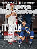 Baseball and Hockey Portrait of St Louis Cardinals pitcher Adam Wainwright and St Louis Blues right wing TJ Oshie posing in locker room during photo...