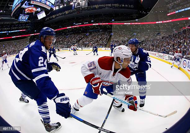 TORONTO ON October 7 2015 Montreal Canadiens David Desharnais gets hit by Toronto Maple Leafs Peter Holland and Matt Hunwick during the second period...