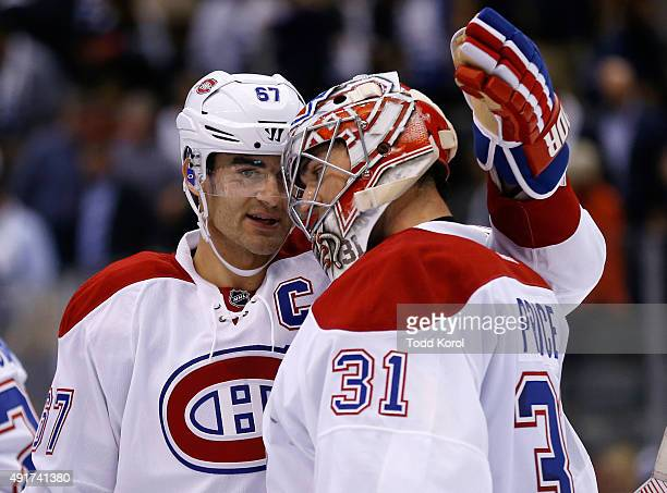 TORONTO ON October 7 2015 Montreal Canadiens Max Pacioretty celebrates with goalie Carey Price after they defeated the Toronto Maple Leafs during...