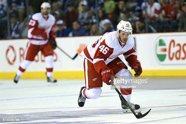 Ben Street of the Detroit Red Wings with the puck during the first period of the NHL preseason game between the Toronto Maple Leafs and the Detroit...