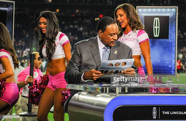 James Brown looks over the Texans calendar prior to the Colts at Texans game at NRG Stadium Houston Texas