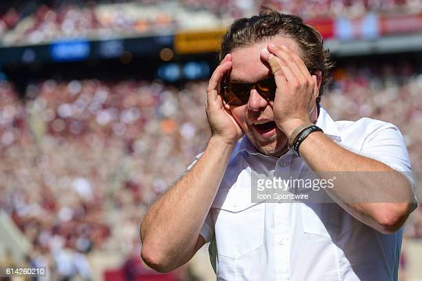 Davey Crockett's 4th generation great grandson is overwhelmed as he departs the field following a pregame presentation before the Tennessee...
