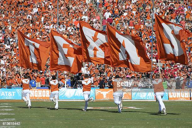 Flag bearers spell out Texas during the game between the Oklahoma Sooners and Texas Longhorns at the Cotton Bowl in Dallas Texas