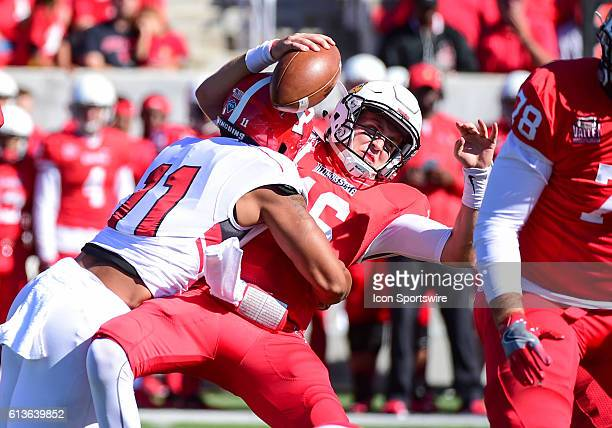 Illinois State Redbirds quarterback Jake Kolbe gets sacked by Youngstown State Penguins defensive end Derek Rivers during a NCAA football game...
