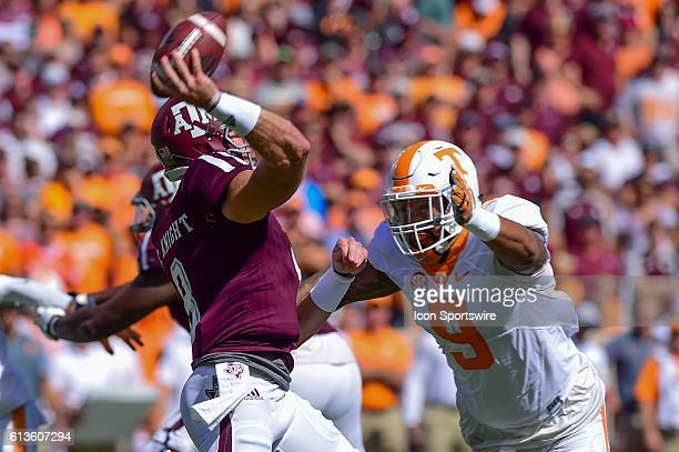 Tennessee Volunteers defensive end Derek Barnett pressures Texas AM Aggies quarterback Trevor Knight into throwing a first half interception during...