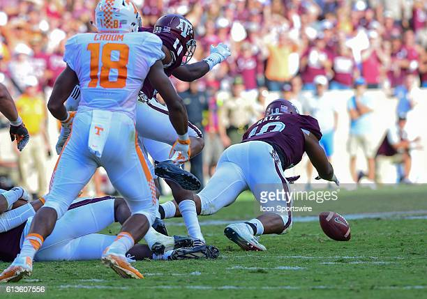 Texas AM Aggies defensive lineman Daeshon Hall dives on a fumble by Tennessee Volunteers quarterback Joshua Dobbs during the Tennessee Volunteers vs...