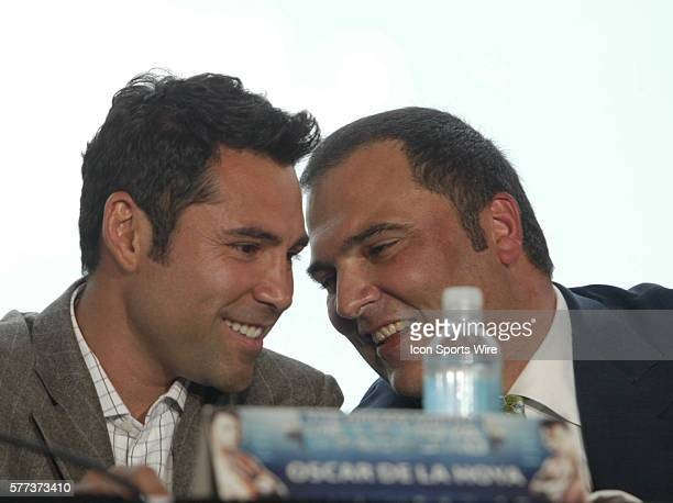 Oscar De La Hoya and Golden Boy Promoter Richard Schaefer share a quiet moment during the NYC press conference for the upcoming Pacquiao De La Hoya...