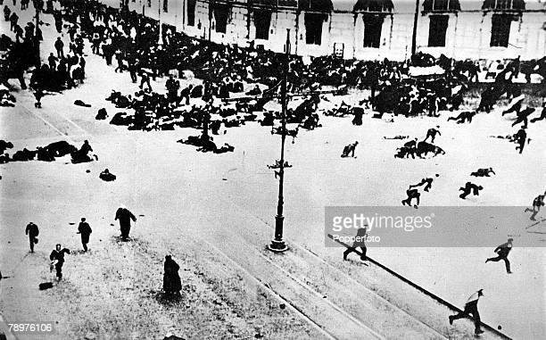 October Russian people race for cover in the streets in front of the Petrograd Winter Palace as Bolshevists fire upon them with machine guns during...