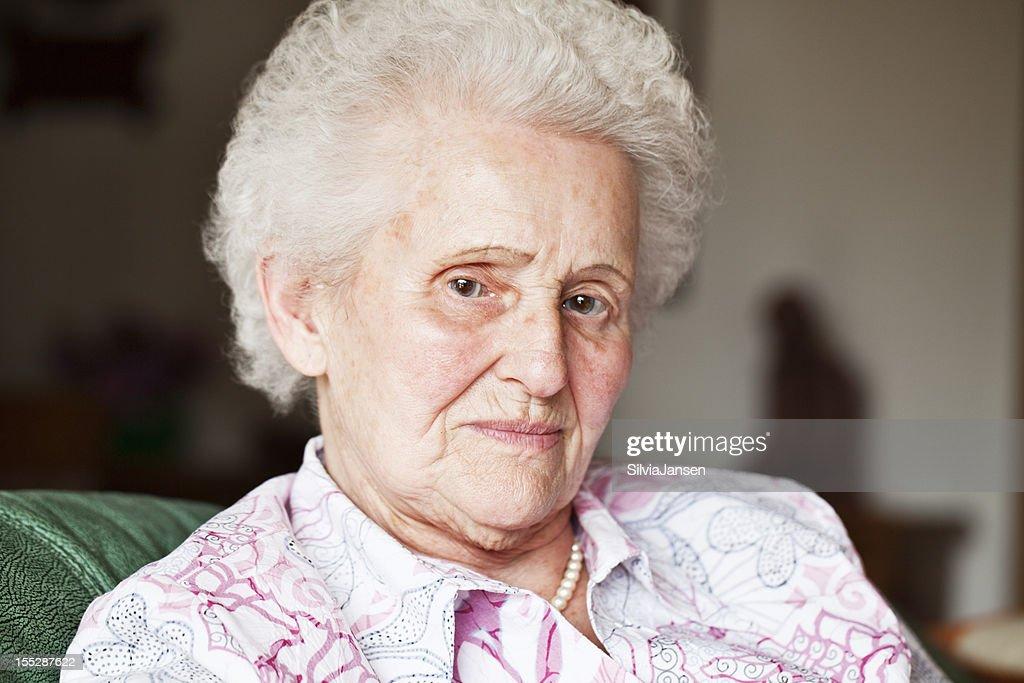 Octogenarian woman pensive mood