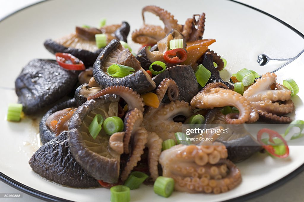 Octopus and vegetables : Stock Photo
