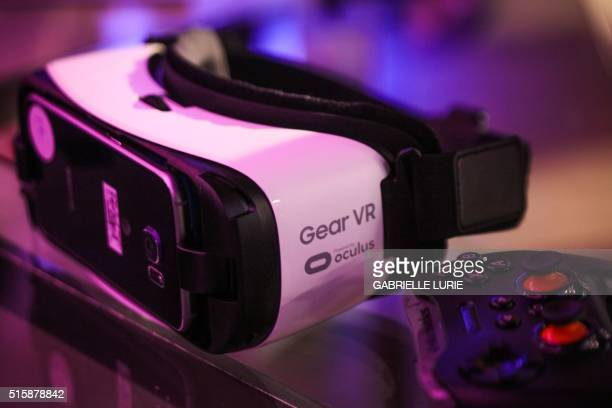 Oculus goggles and a remote for Gear VR sit on a table at the Minecraft for Gear VR demonstration at The Village event space in San Francisco...