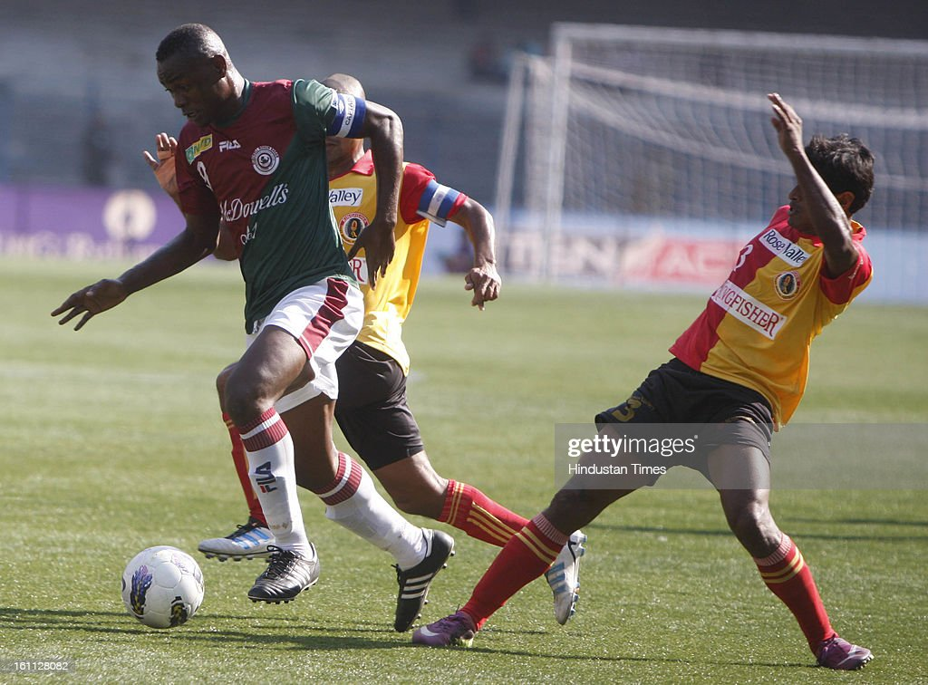 Odafa (R) of Mohun Bagan is trying to beat Arnab Mondal (L) of East Bengal during the derby match of I-League at Yuba Bharati Krirangan, Salt Lake on February 9, 2013 in Kolkata, India.