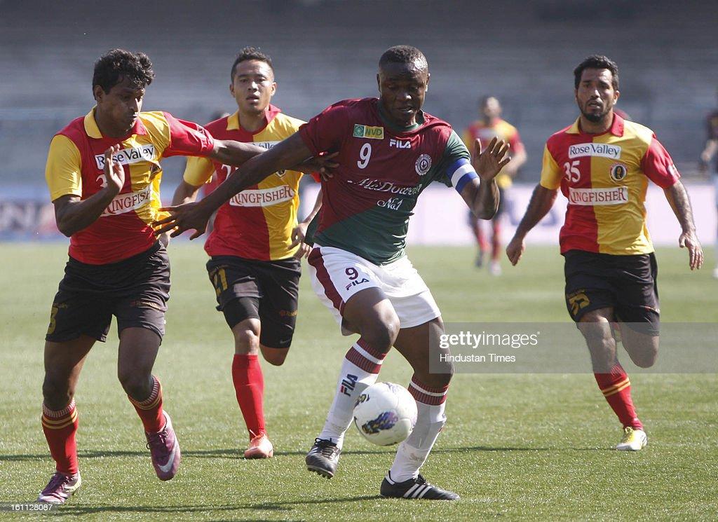 Odafa (R) of Mohun Bagan is trying to beat Arnab Mondal (L) of East Bengal during the derby match of I-League at Yuba Bharati Krirangan, Salt Lake on February 9, 2013 in Kolkata, India.