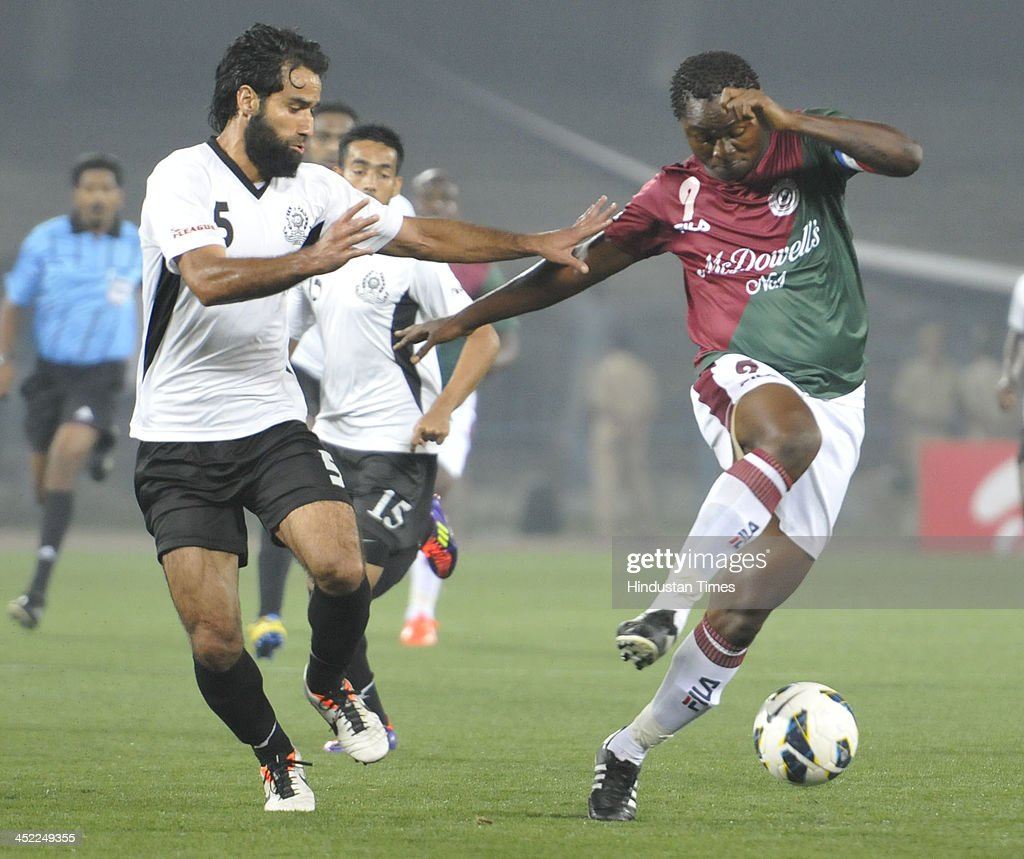 Odafa (R) of Mohun Bagan is trying to beat Mehrajuddin of Mohammedan Sporting during their I-League match at Yuba Bharati Krirangan, Salt Lake City on November 27, 2013 in Kolkata India.