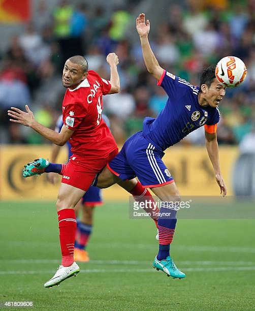 Odai Al Saify of Jordan and Makoto Hasebe of Japan compete for the ball during the 2015 Asian Cup match between Japan and Jordan at AAMI Park on...
