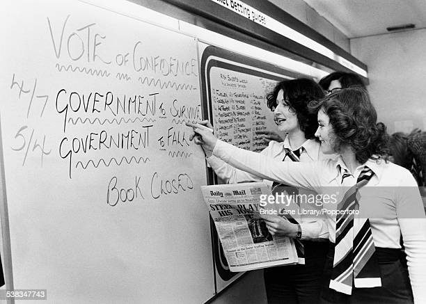 Odds on the board at Ladbrokes in London on the vote of confidence to be taken on the government in the House of Commons the next day 22nd March 1977