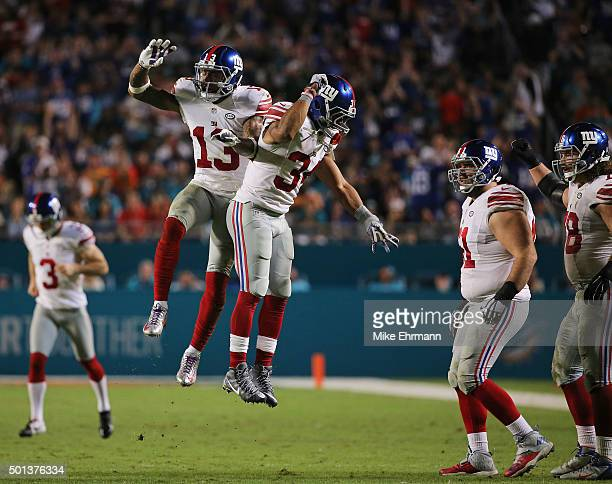 Odell Beckham celebrates with Shane Vereen of the New York Giants after scoring a touchdown during the third quarter of the game against the Miami...