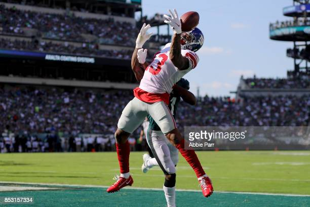 Odell Beckham Jr #13 of the New York Giants completes a four yard touchdown catch against Jalen Mills of the Philadelphia Eagles on September 24 2017...