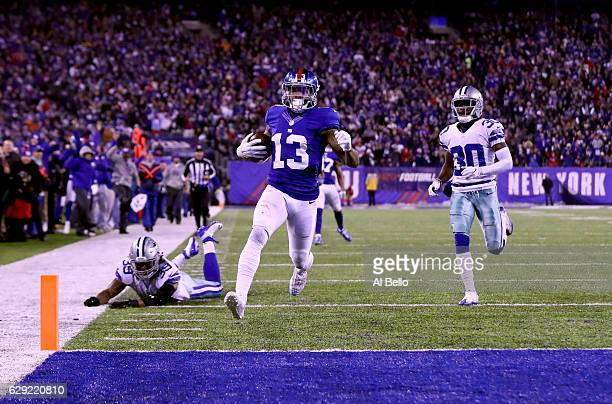 Odell Beckham Jr #13 of the New York Giants scores a 61 yard touchdown against the Dallas Cowboys during the third quarter of the game at MetLife...