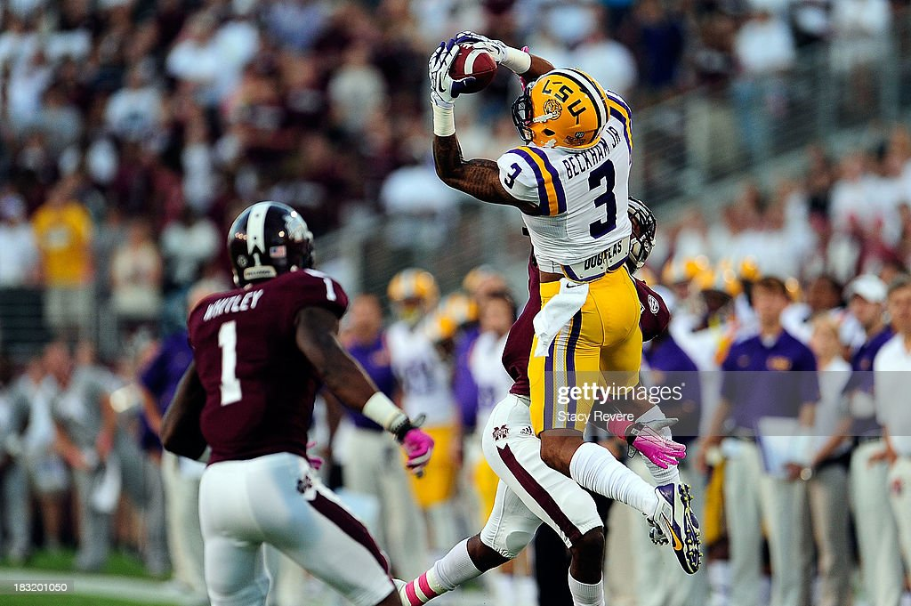 Odell Beckham Jr. #3 of the LSU Tigers goes up for a reception in front of Nickoe Whitley #1 of the Mississippi State Bulldogs during a game at Davis Wade Stadium on October 5, 2013 in Starkville, Mississippi. LSU won the game 59-26.