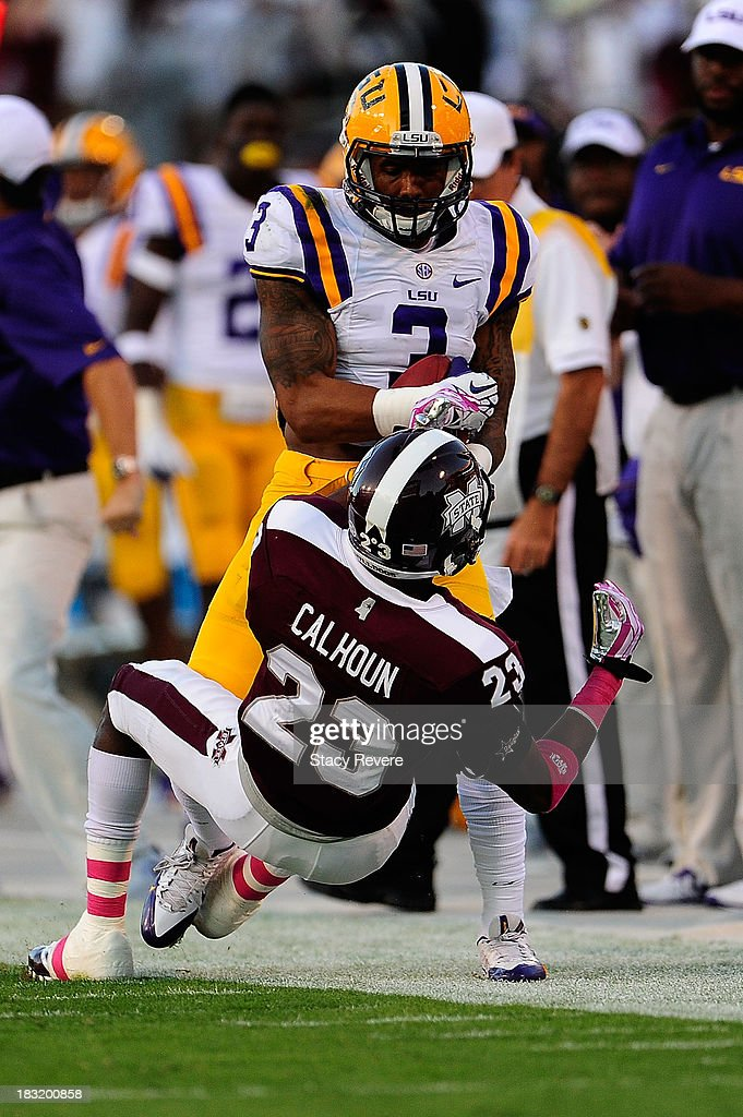 Odell Beckham Jr. #3 of the LSU Tigers is pushed out of bounds by Taveze Calhoun #23 of the Mississippi State Bulldogs during a game at Davis Wade Stadium on October 5, 2013 in Starkville, Mississippi. LSU won the game 59-26.