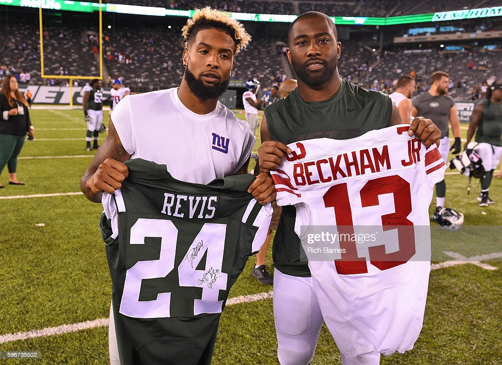 Odell Beckham #13 of the New York Giants and Darrelle Revis #24 of the New York Jets exchange jerseys following a preseason game at MetLife Stadium on August 27, 2016 in East Rutherford, New Jersey. The Giants defeated the Jets 21-20.
