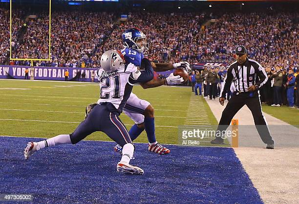 Odell Beckham of the New York Giants cannot hold onto the ball which is broken up in the end zone by Malcolm Butler of the New England Patriots in...