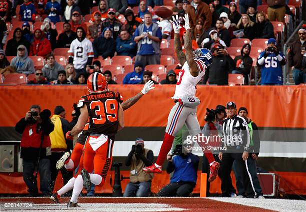 Odell Beckham of the New York Giants can't make a catch inbounds in front of the defense of Ed Reynolds II of the Cleveland Browns during the fourth...