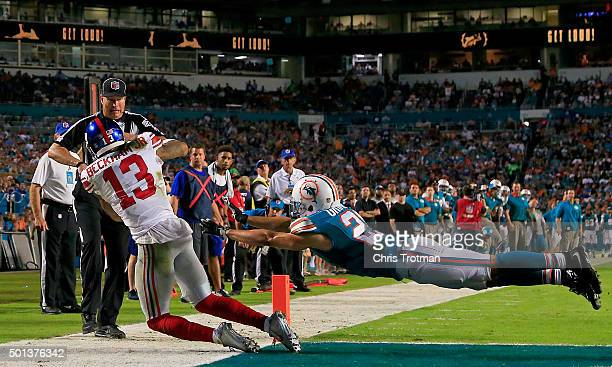 Odell Beckham of the New York Giants catches a touchdown pass as Brent Grimes of the Miami Dolphins defends during the third quarter of the game at...