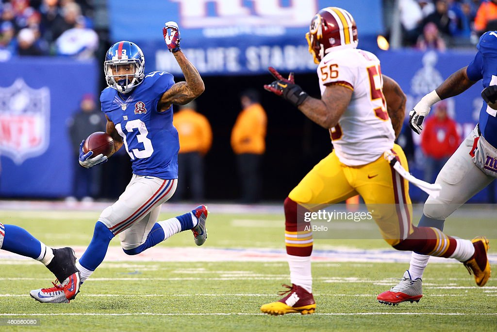 Odell Beckham of the New York Giants in action against Perry Riley of the Washington Redskins during their game at MetLife Stadium on December 14...