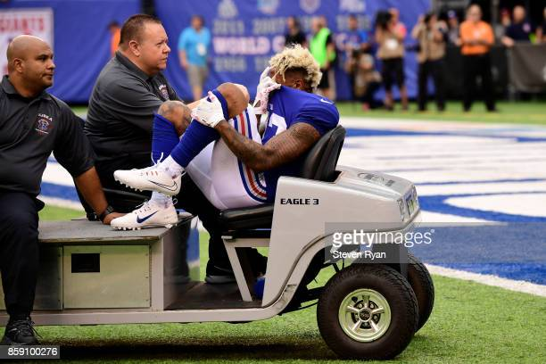 Odell Beckham of the New York Giants is carted off the field after sustaining an injury during the fourth quarter against the Los Angeles Chargers...