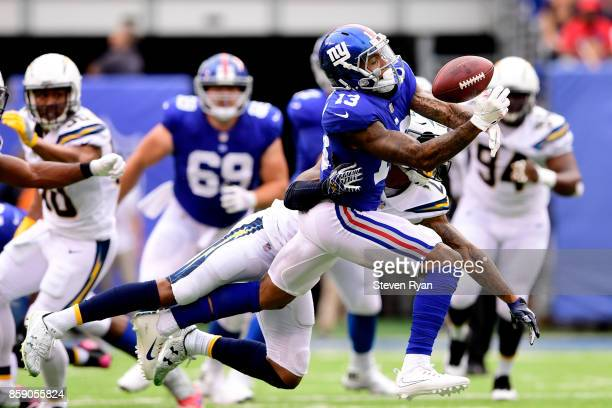Odell Beckham of the New York Giants makes a first down catch during the first quarter under pressure from Trevor Williams of the Los Angeles...