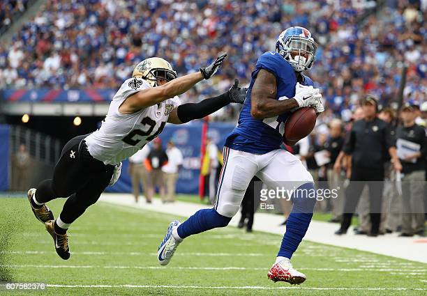 Odell Beckham of the New York Giants missess a catch in the final minutes of the game against Sterling Moore of the New Orleans Saints during the...