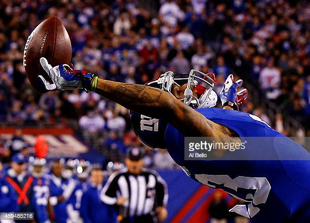 Odell Beckham of the New York Giants scores a touchdown in the second quarter against the Dallas Cowboys at MetLife Stadium on November 23 2014 in...