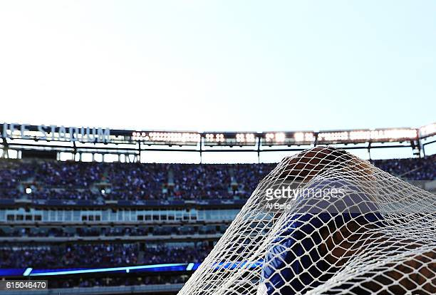 Odell Beckham of the New York Giants sticks his head through the kicking net after scoring the go ahead touchdown against the Baltimore Ravens in the...