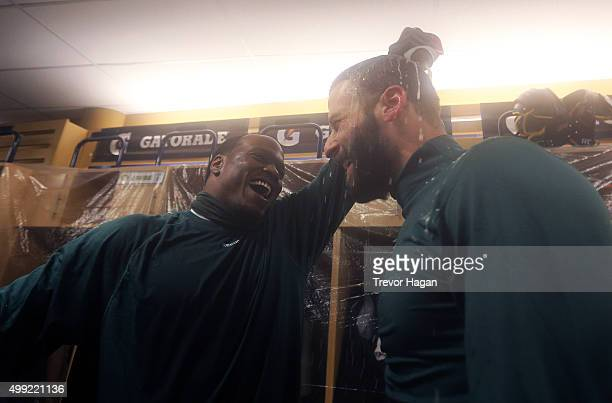 Odell Willis of the Edmonton Eskimos pours beer on Mike Reilly while celebrating in the locker room after winning Grey Cup 103 against the Ottawa...