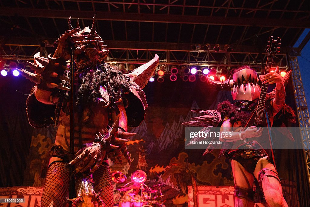 Oderus Urungus and Beefcake the Mighty of Gwar perform on stage on Day 1 of Riot Fest and Carnival 2013 at Humboldt Park on September 13 2013 in...