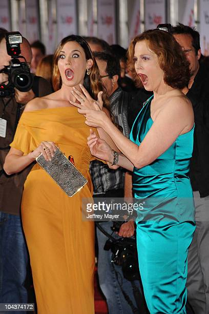Odette Yustman and Sigourney Weaver arrive at the 'You Again' Premiere at the El Capitan Theatre on September 22 2010 in Hollywood California