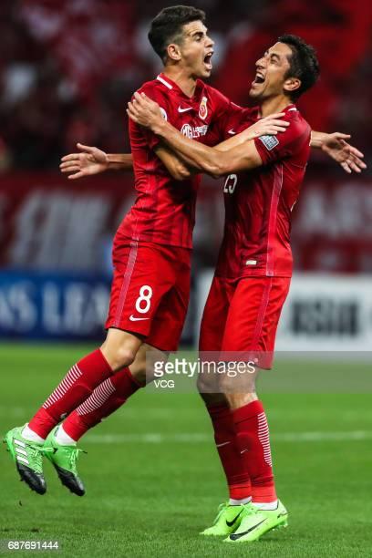 Odil Ahmedov and Oscar of Shanghai SIPG celebrate a goal during 2017 AFC Champions League eighthfinal match between Shanghai SIPG FC and Jiangsu...