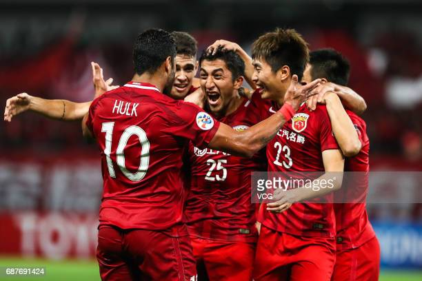 Odil Ahmedov and teammates of Shanghai SIPG celebrate a goal during 2017 AFC Champions League eighthfinal match between Shanghai SIPG FC and Jiangsu...