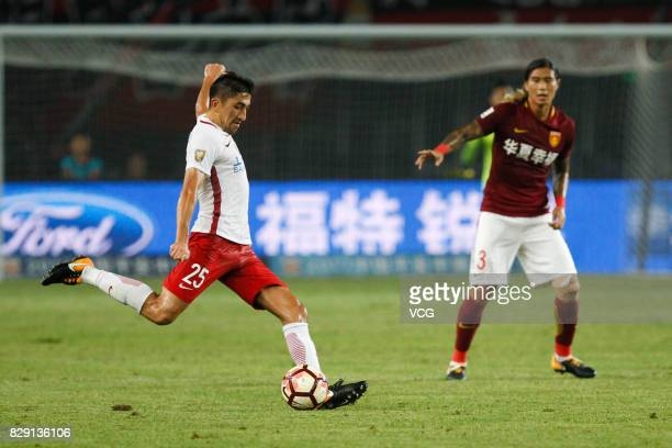 Odil Ahmedov of Shanghai SIPG kicks the ball during the 21st round match of 2017 China Super League between Hebei China Fortune FC and Shanghai SIPG...